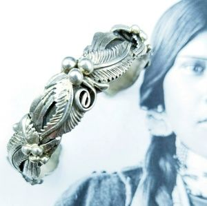 Vintage Sterling Navajo Leaves/ Feathers bracelet